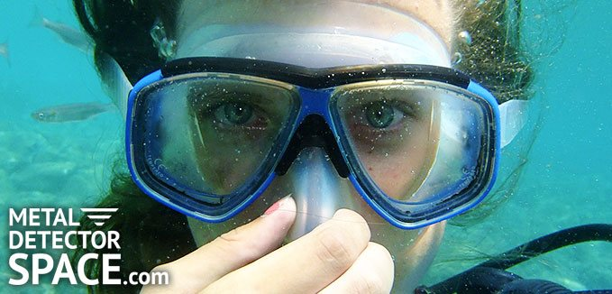 Person underwater wearing goggles